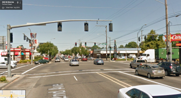 SE. 82nd and Powell, Portland August 2016. Also a traffic-dominated space but now with street trees! Note the KFC is still on the northwest corner of the picture.